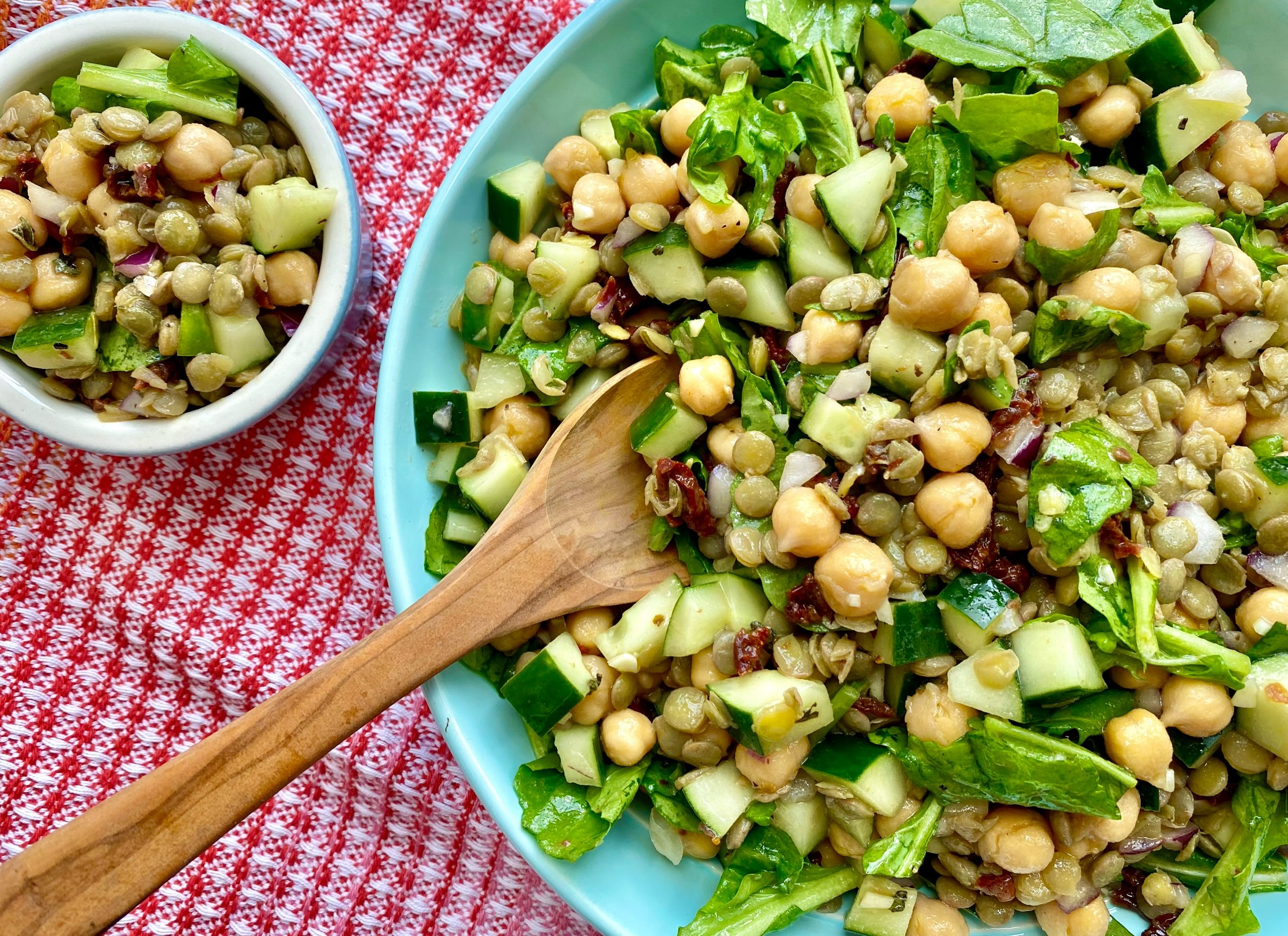 chickpea and lentil summer salad in blue bowl with side dish