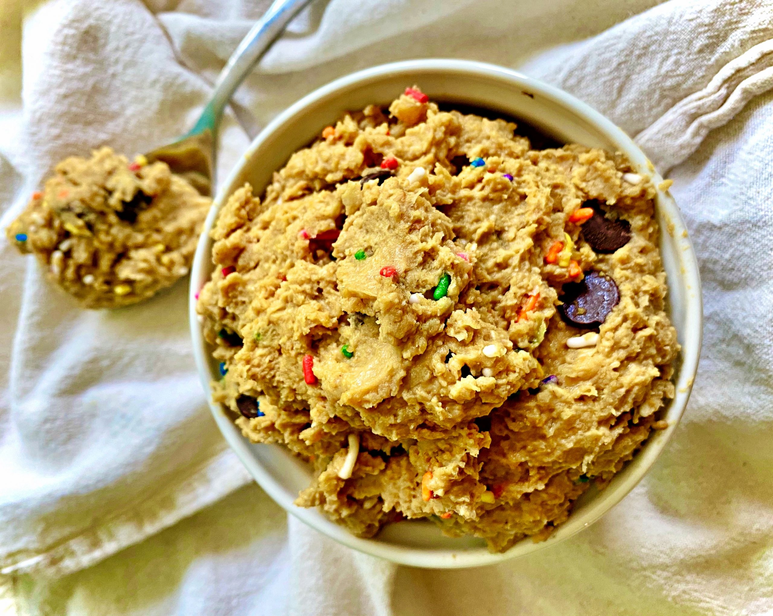 Edible Cookie Dough in serving ramekin with spoonful on table