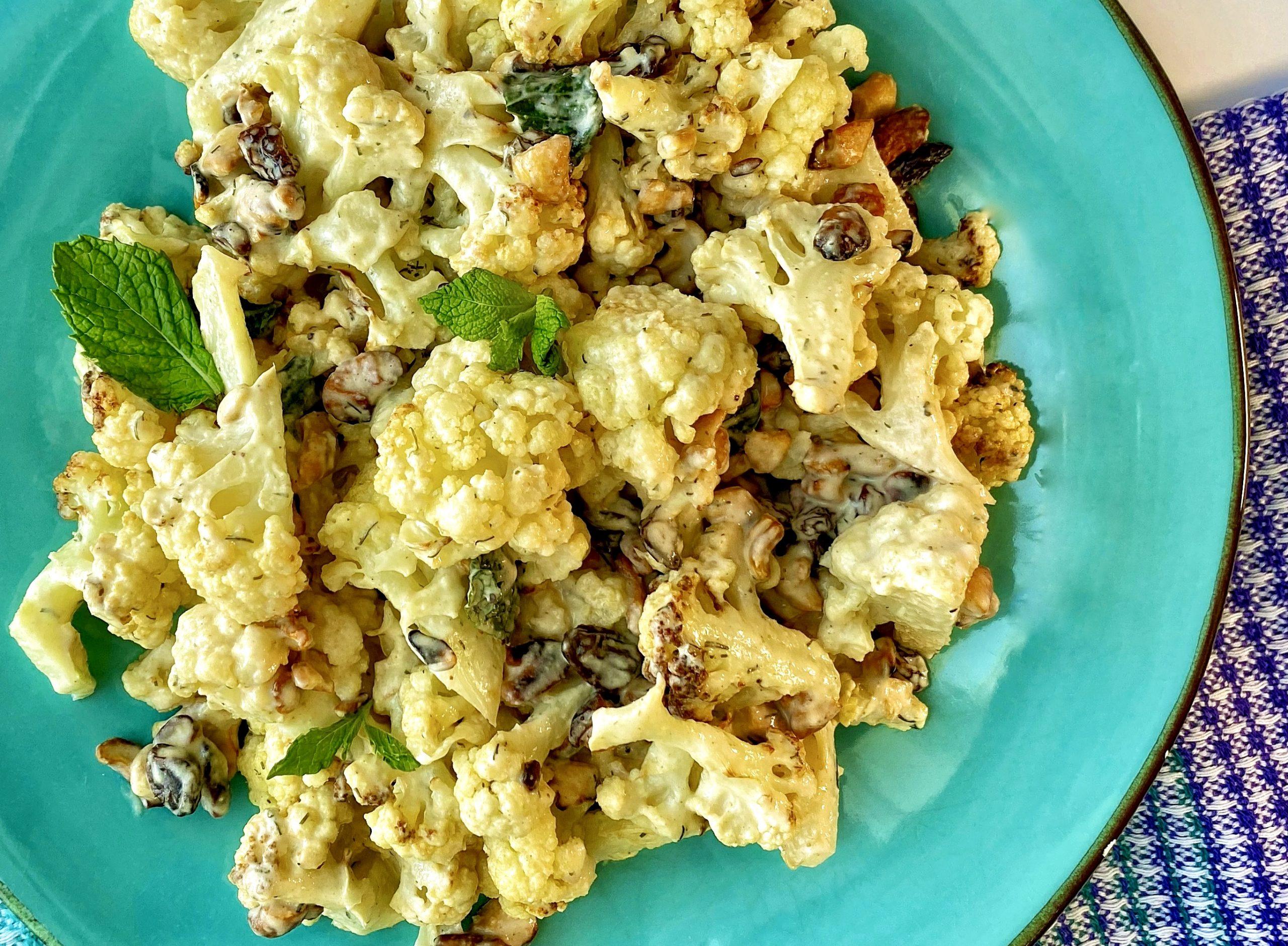 Roasted Tahini Cauliflower served on blue plate